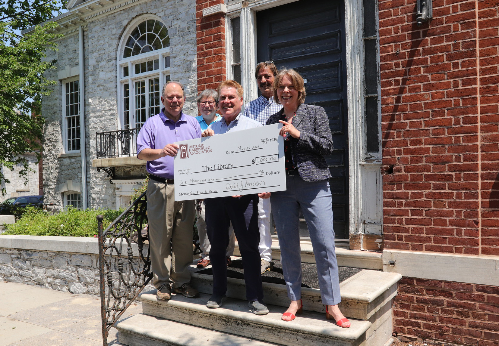 The Historic Harrisburg Association presented a $1,000 check toward the unique renovation and preservation project to join the McCormick Riverfront Library with the adjacent home of its founder.